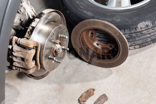 brake disc. Replacement of the old to the new. Auto mechanic repairing .