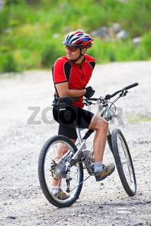Mountain biker waits on rural road