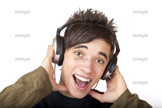 Male Teenager listening to music and sings loudly