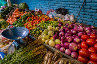 Fresh vegetables on market with old scale