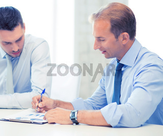businessmen with notebook on meeting