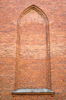 Vintage brick wall with arch