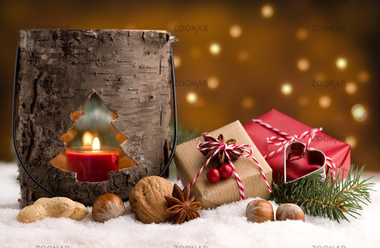 Christmas decoration - Cute presents and wooden lantern in the snow
