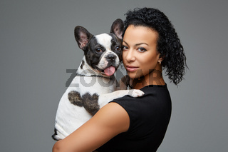 young woman with french bulldog dog
