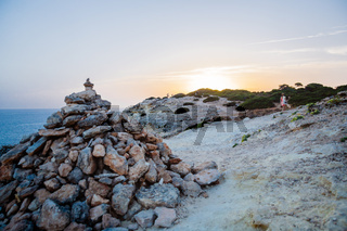 Sunset view on the footpath of the Algarve coast near to Carvoeiro, Portugal