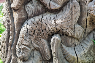 The figure of a fish carved on the tree trunk.