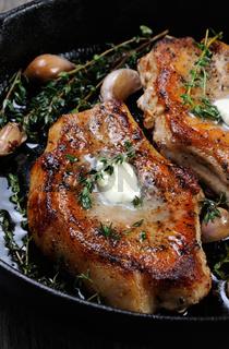 Roasted pork steak in frying pan