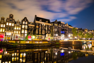 View of the Amsterdam canals and embankments along them at night