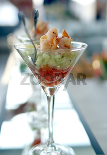 Shrimp cocktail in a martini glass with fork inside.