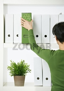 Female office worker with green folder