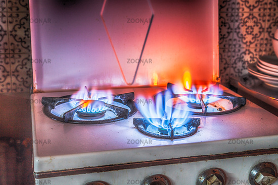 old gas stove with three fires