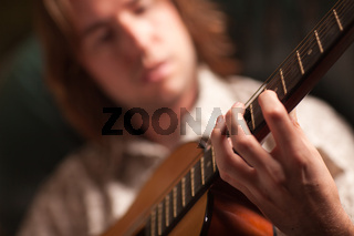 Young Musician Plays His Acoustic Guitar