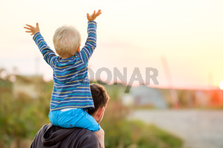 Father and son outdoor portrait in sunset sunlight