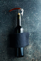 Bottle of wine with corkscrew.