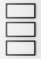 three blank black photo frames on white wall