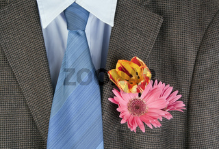 Flowers  in a pocket of an  brown jacket