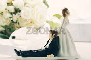 Whimsical wedding cake figurines on white