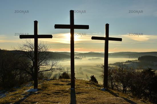 Crosses; Sunrise; Swabian Alb; Germany;
