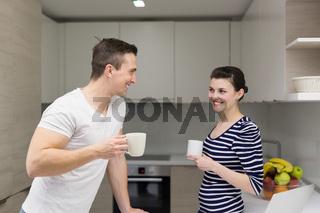 couple with laptop computer enjoying morning