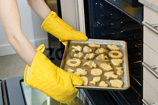 Taking cookies from oven