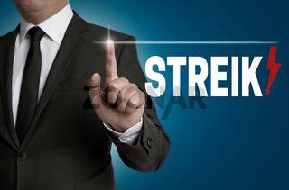 streik Touchscreen wird von Geschäftsmann bedient Konzept