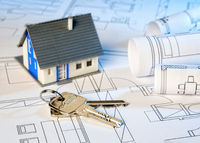Construction plans with house and key