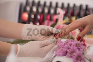 Woman hands receiving a manicure