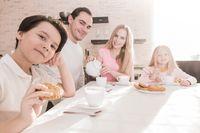 Family with children having breakfast