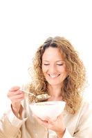 young woman eats cereals
