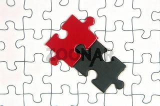 Puzzle rot schwarz