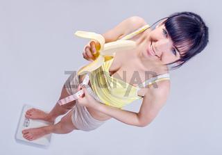 beautiful girl measuring her waist