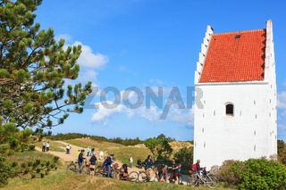 Young people on a bike trip to the Sand-Covered Church in Skagen