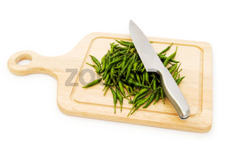Pepper and cutting board isolated on the white