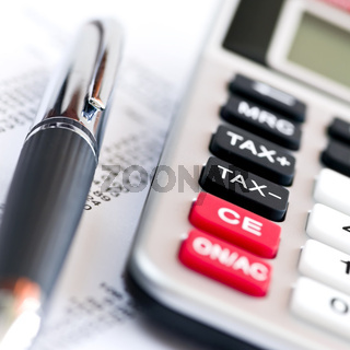 Tax calculator and pen