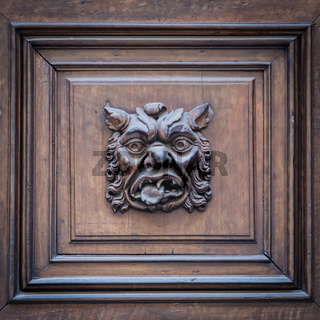 Italy - Mask on an old door