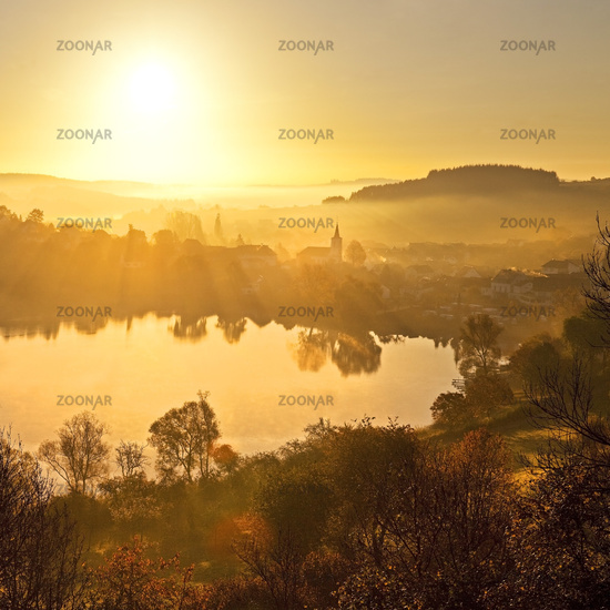 Schlakenmehren maar in autumn at sunrise, Daun, Eifel, Rhineland-Palatinate, Germany, Europe
