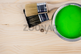 Paint bucket on a wooden background