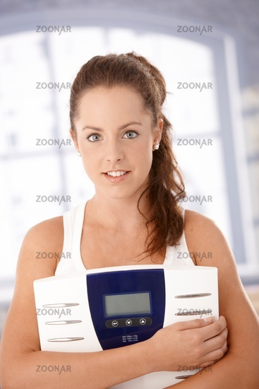 Portrait of pretty girl with scale dieting