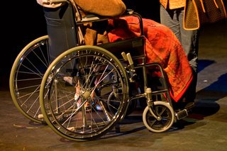 Handicapped woman sitting on wheelchair