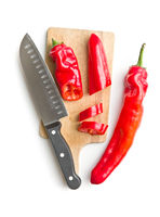 Red peppers on cutting board.