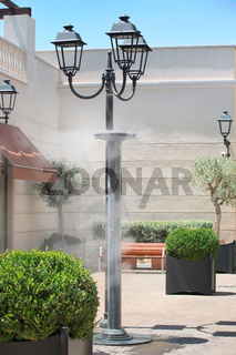 Sprinklers splashing vaporized water at street in order to cool the hot summer temperature in ItalyEquipment