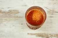 Gass of fresh tomato juice, flat view