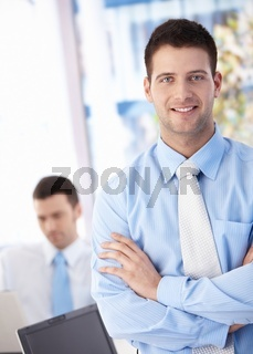 Happy businessman smiling in office