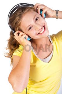 Attractive girl enjoying music