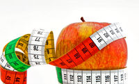Apple and measuring tape as a symbol for losing weight