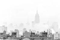 Misty New York City Manhattan skyline with Empire State Building.