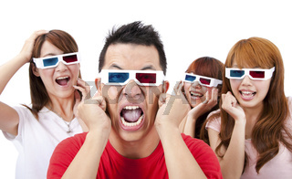 Surprised Young people in 3D glasses and watching a movie
