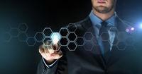 businessman touching virtual hexagonal projection