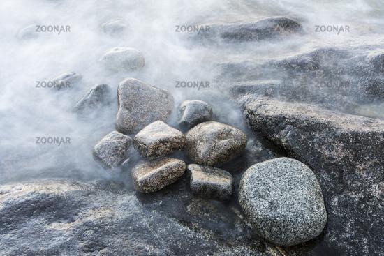 Stones in water, world heritage Hoega Kusten, Sweden
