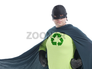 Eco superhero with green recycle arrow symbol on chest posing confidently over white background - recycle concept